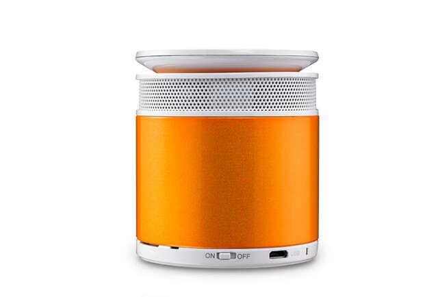 A speaker shaped like a can with a wider degree of sound