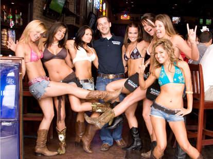 Bikini'd waitresses at Bikinis