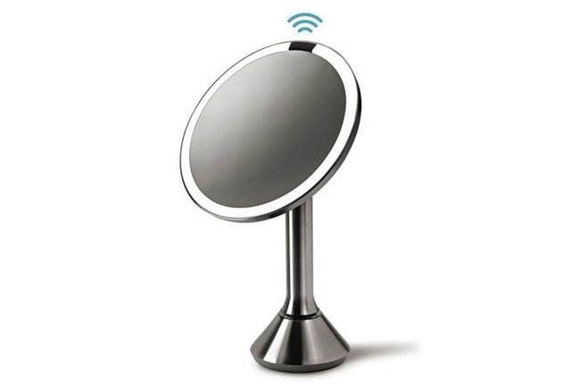 A wireless mirror with an automatic lighting system