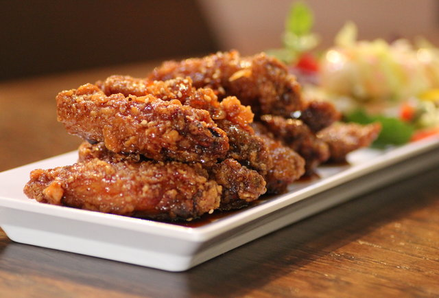 Garlic soy wings and three giant projectors
