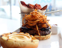A burger topped with crispy onions