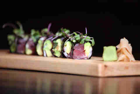 Sushi with tuna and topped with greens