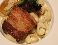 Crispy pork belly atop truffle mac and cheese