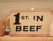 "A sign that reads ""1st in Beef"""