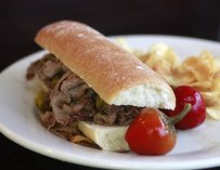 Gravy-soaked Italian beef sandwich w/ hot peppers