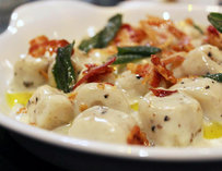 Gnocchi with truffle cream, crispy pancetta, and fried sage