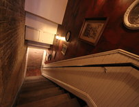A stairwell leading to the restaurant