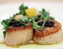 Scallops topped with caviar