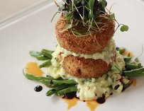 Dungeness crab cakes slathered in truffled risotto & pork belly
