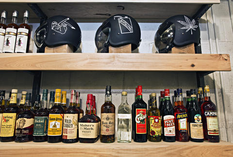 Booze and motorcyle helmets on display
