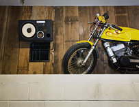 A yellow motorcylce on display