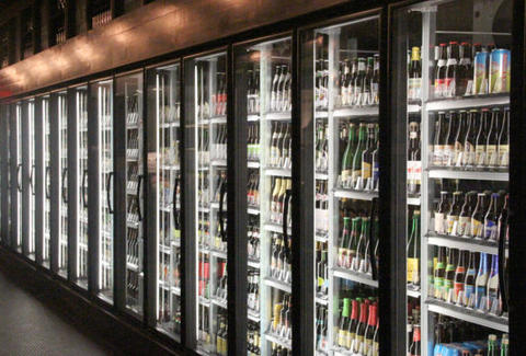 Help yourself to fridges on fridges of alcohol at The Corner Foodery