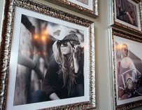 A picture of a girl wearing a cowboy hat hanging on the wall