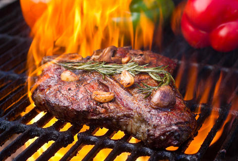 Steak on a fiery grill