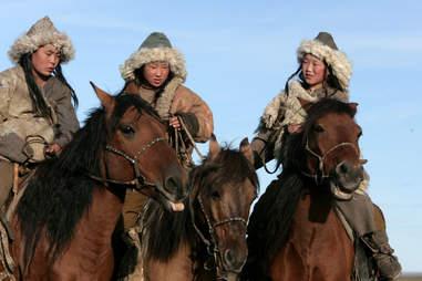 Mongoligan girls on horseback