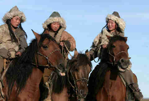 Mongoligan girls on horseback