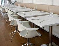 White tables and chair in Terzo Piano's interior.