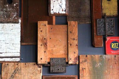 The wood paneling inside Cedar Point Bar & Kitchen includes this block resembling a Ritz Cracker box