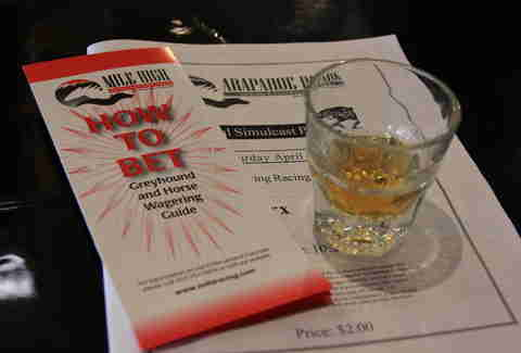 "a shot, a ""how to bet"" pamphlet, and a racing program at The Celtic Tavern"