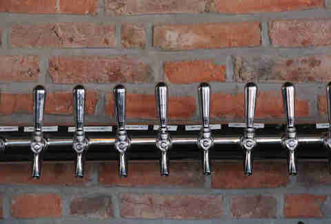 Cedar Point Bar & Kitchen's 15 beer taps built into the exposed brick barroom wall