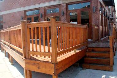 The deck at Cedar Point Bar & Kithen, facing the corner of Cedar St
