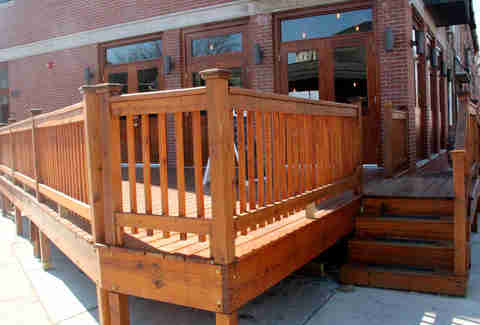 The deck at Cedar Point Bar & Kithen, facing the corner of Cedar St