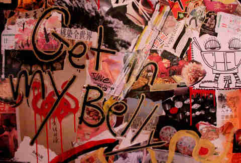 "Graffiti on the decoupaged back wall reads ""Get in my belly"""