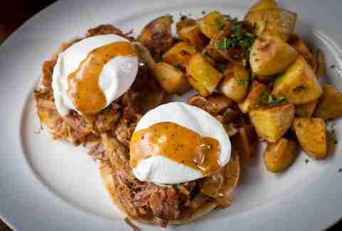 Brunch's roast pork eggs benedict.