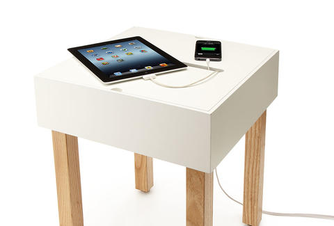 Hub Table charging an iPad and iPhone