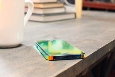Multi-tinted Aurora skinned iPhone sitting on a table