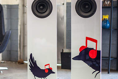 Pair of musical-themed speakers standing next to one another
