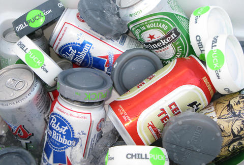 Chill Pucks in a cooler full of beers
