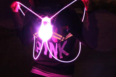 Pink Tracer360 being held up in the dark