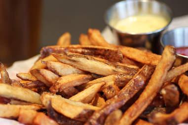 Estelle's fries w/ hot sauce
