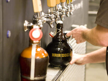 Growlers being filled at Growler Room