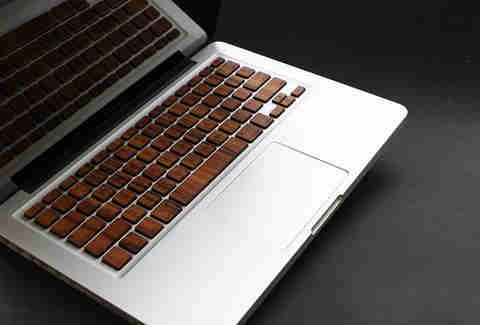 MacBook keyboard covered with wooden skins