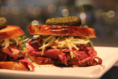A pickle-topped duck pastrami Reuben at 28 West