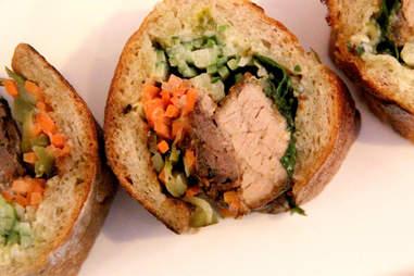 A trio of slow-roasted pork banh mi on crispy baguette at 28 West