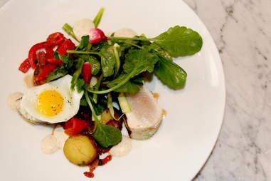 The Wahoo salad of quail egg and Benton's bacon