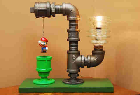 Lamp with Mario as the pull string, hanging above a green pipe