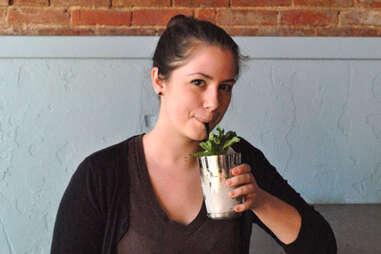 A patron drinks a mint julep at Silver Dollar Louisville