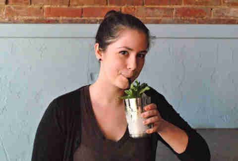 A patron drinks a mint julep at Silver Dollar Louisville