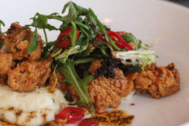 creole-buttered fried oysters at 21C Museum Hotel's Proof on Main restaurant