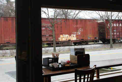Trains passing down Frankford Ave outside Blue Dog Bakery in Louisville, KY