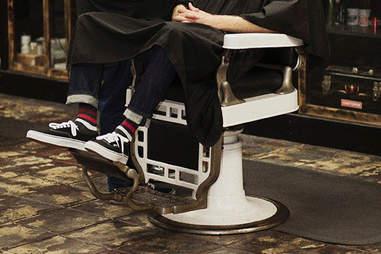 Guy in barber chair in socks from SockFancy