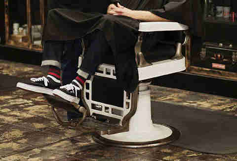 Guy in barber chair in socks from SockFancy