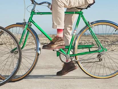 Guy riding bike in striped socks