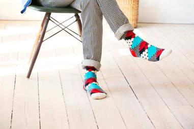 Guy sitting in colorfully striped socks