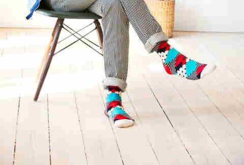 Guy sitting in colorfully striped socks