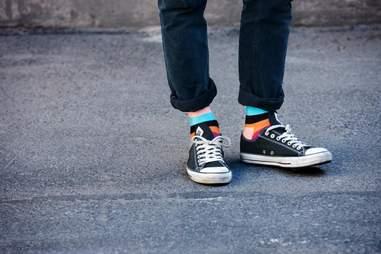 Guy in colorblocked socks